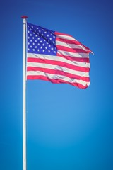 American flag on the blue sky - retro and vintage style