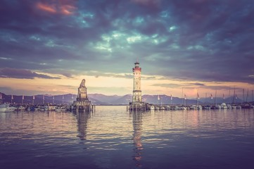 Beautiful evening seascape with lighthouse in harbor of Lindau -