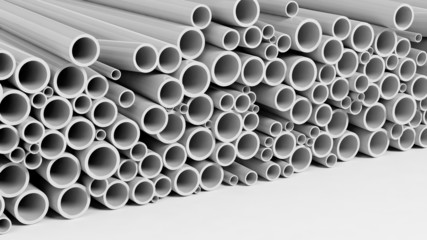 White plastic pipe stacks isolated on white background