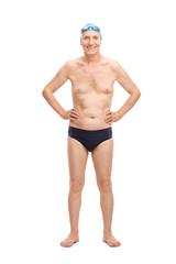Senior in black swim trunks and blue swimming cap