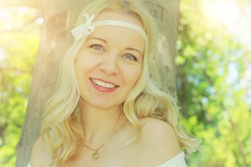 Portrait of beautiful young woman with headband