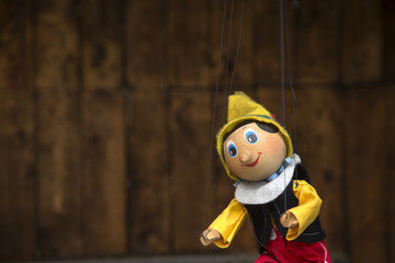 Old wooden pinocchio marionette toy .