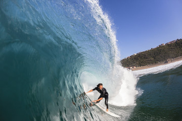 Surfing Surfer rides Inside Large Blue Hollow crashing ocean wave swimming photo action