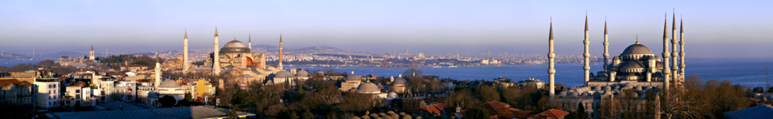 Wide angle panorama Istanbul old city district at daylight including most famous touristic attractions Sophia and Sultan Ahmed Blue Mosque with water Bosporus and Asian side town on background