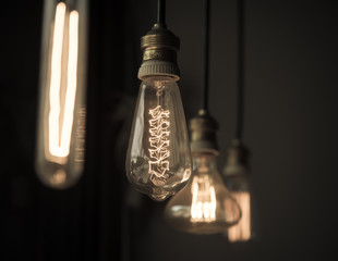 Hanged light bulbs in dark room vintage