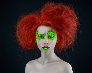 girl red hair green red makeup