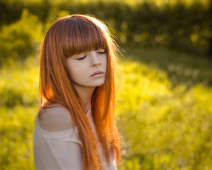 girl with red hair, Red-haired girl standing in the woods and the sun shines