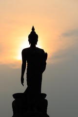 Silhouette of standing Buddha Statue at Twilight