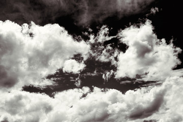 Cumulus clouds in black and white for dramatic effect.