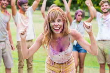 Happy friends throwing powder paint