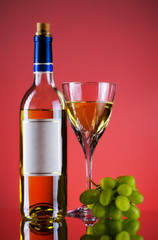 bottle and glass of wine, grape bunch