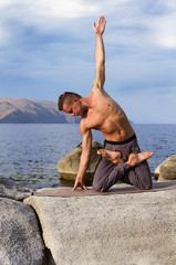 man is engaged in gymnastics, yoga in nature