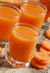 Fresh carrot juice in the glass, selective focus