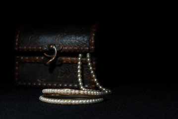 Vintage box with jewelry on black background
