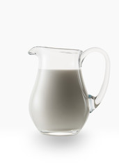 Milk. Glass jug of fresh milk isolated on white background