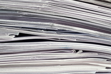 Tax time preparations with stack of documents closeup.