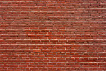Brick wall. The traditional brickwork made of red bricks.