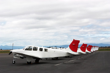 Airplanes standing in row on private parking