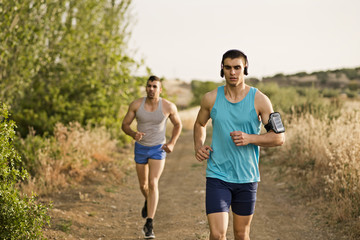 Runners friends in the road in sunny day