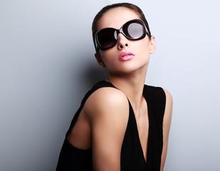 Beautiful perfect young woman posing in fashion sunglasses