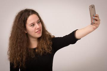 Teenage Woman Taking Self Portrait