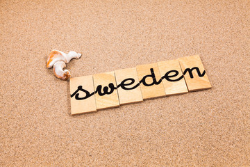 Words formed from small pieces of wood containing a sun and beach tourist destination, Sweden