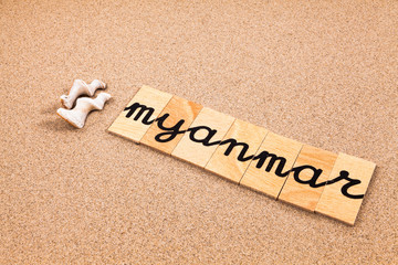 Words formed from small pieces of wood containing a sun and beach tourist destination, Myanmar