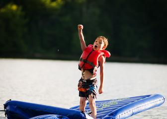 little boy having fun in a lake