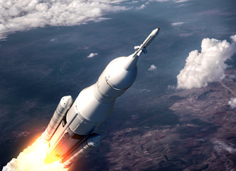Space Launch System Flying Over The Clouds