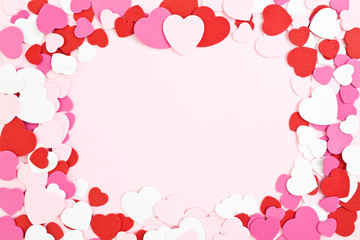 Valentine's Day Border & Background, pink red and white heart shapes with copy space in the center.
