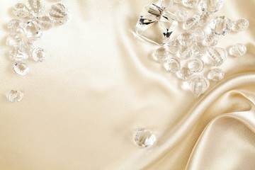 Luxurious Satin & Gems, diamond and crystal shapes with copy space.