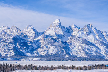 Yellowstone mountain teton national park with snow on winter time background