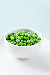 Healthy Green Peas in a white bowl ready to eat.