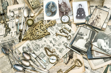 Antique utensils, photos and news papers. Collectible goods