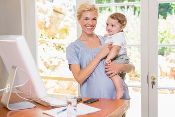 Blonde woman with his son using computer