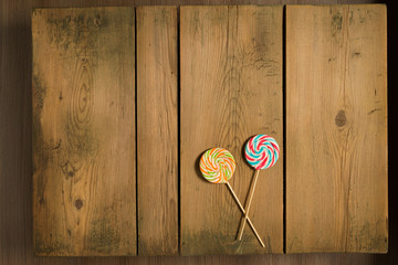 Christmas candy on picnic table/Holiday sweets on wooden table