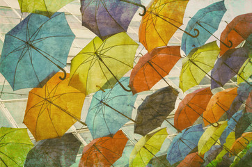 Lots of umbrellas coloring the sky overlaid with grunge texture.