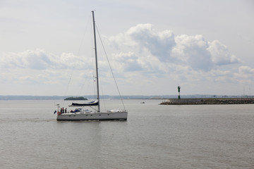 yacht going from port to sea on the motors