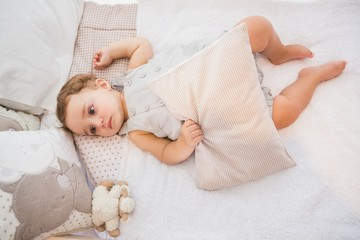 Portrait of a child in his bed with pillow