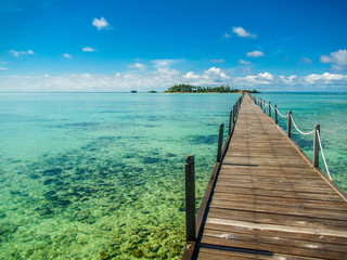 Pier leads to a tropical island