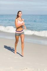 Fit woman walking beside the sea