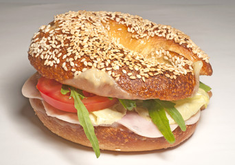 Big bagel sandwich with tomato cheese and ham