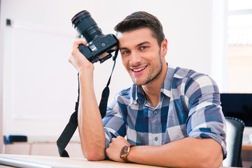Man sitting at the table with camera
