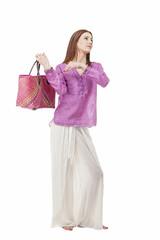 Beautiful woman with summer beach bag.