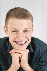 Portrait of smiling teenage boy with braces