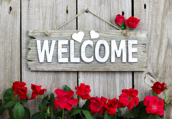 Welcome sign with hearts and red rose border