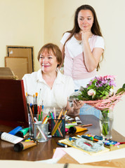 Woman paints a picture for her admirer