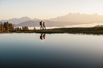 Austria, young couple at mountain lake in the Lower Tauern