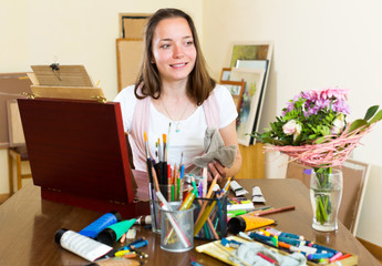young artist paints a picture