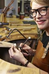Portrait of goldsmith in workshop at work
